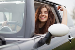 Young beuatiful woman driving a car Stock Photo