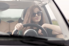 Young beuatiful woman driving a car Stock Photos
