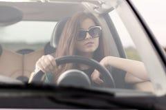 Young beuatiful woman driving a car Stock Photos