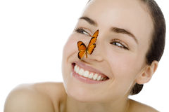 Young beutiful woman with butterfly Royalty Free Stock Photos