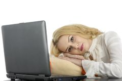 Young beutiful women sleeping with laptop Royalty Free Stock Images