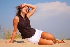 Young beuty woman sit on sand Royalty Free Stock Photography