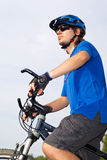 Young bicyclist in helmet Royalty Free Stock Image