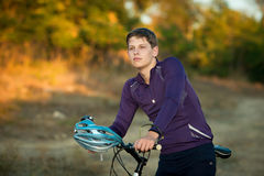 Young bicyclist in helmet Stock Image