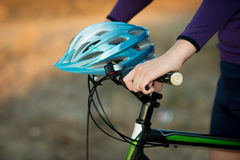 Young bicyclist in helmet. On a mountain bike royalty free stock image