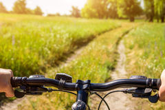 Young bicyclist riding in the field Stock Photo