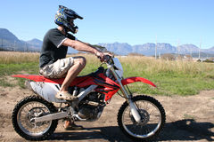 Young Biker. Sitting on an off road bike, waiting to ride the track Royalty Free Stock Photos
