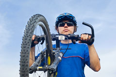 Young biker and bicycle Stock Image