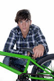 Young,  biker with BMX. And looking at camera. Isolated on white background Stock Images