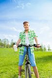 Young biker with bottle of water Stock Photos
