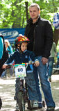 Young biker boy on child bicycle competition. Stock Photos