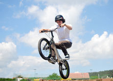 Young biker boy does tricks in the air Stock Image