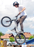 Young biker boy does tricks in the air Royalty Free Stock Photography