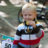 Young biker boy with medal. Stock Photography