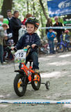 Young biker on child bicycle competition. Stock Images