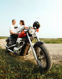 Young biker couple on the country road Stock Image