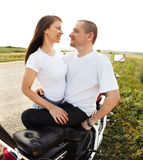 Young biker couple on the country road Royalty Free Stock Photography