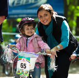 Young biker girl on child bicycle competition. UKRAINE, KIEV - September 11: Young biker girl with mother, at the child amateur bicycle competition We are the Royalty Free Stock Photo