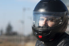Young biker with helmet Stock Images