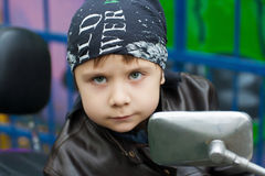 Young biker on a motorcycle Stock Photography