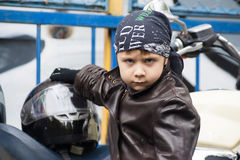 Young biker on a motorcycle Royalty Free Stock Images