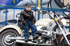 Young biker on a motorcycle Royalty Free Stock Photos