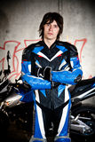 Young biker in protection suit Stock Photo
