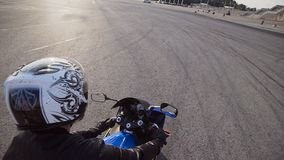 The young biker rides on his motorcycle stock video footage