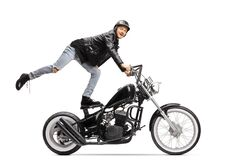 Free Young Biker Standing On The Seat And Riding A Motorbike Royalty Free Stock Images - 178590719
