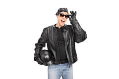 Young biker with sunglasses and leather jacket Stock Images