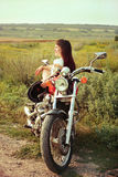 Young biker woman on the country road Royalty Free Stock Photo