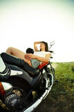 Young biker woman on the country road Stock Photo
