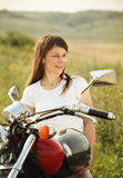 Young biker woman on the country road Stock Photos