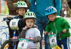Young bikers on child bicycle competition. Royalty Free Stock Photo