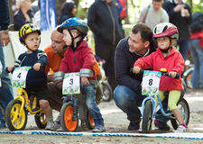 Young bikers on child bicycle competition. Stock Photo