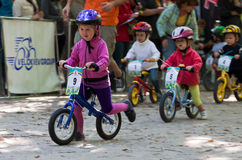 Young bikers on child bicycle competition. Royalty Free Stock Images