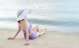 Young bikini girl with hawaii hat royalty free stock photo