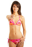 Young bikini girl pointing a finger Royalty Free Stock Photos