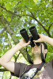 Young bird watcher holding binoculars Stock Images