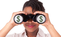Young black / african  american business woman using binoculars Stock Photo