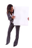 Young black African American woman holding a blank board - Afric. Young black African American woman holding a blank board, isolated on white background Stock Image