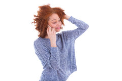 Young black African American woman making a phone call on her sm Royalty Free Stock Images