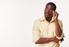 Young  black african man thinking and reminiscing Royalty Free Stock Image