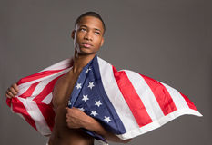 Young Black Athlete Holding American Flag Royalty Free Stock Photos
