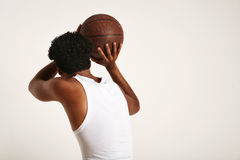 Young black athlete throwing a basketball royalty free stock image