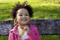 Young black baby girl. With glasses Stock Image
