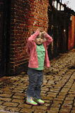 Young black baby girl playing. On cobble stoned alley Stock Images