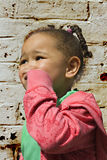 Young black baby girl playing. In an alley Royalty Free Stock Photos