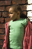 Young black baby girl playing. In an alley Stock Image