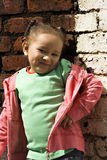Young black baby girl playing. In an alley Royalty Free Stock Images